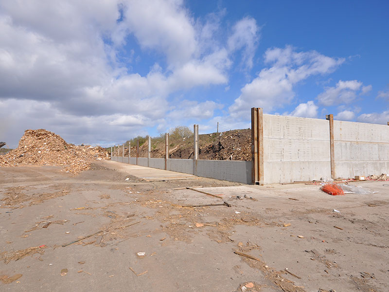 1200mm high Prestressed Wall Panels used to form retaining walls for storage area for recycled timber in central Scotland