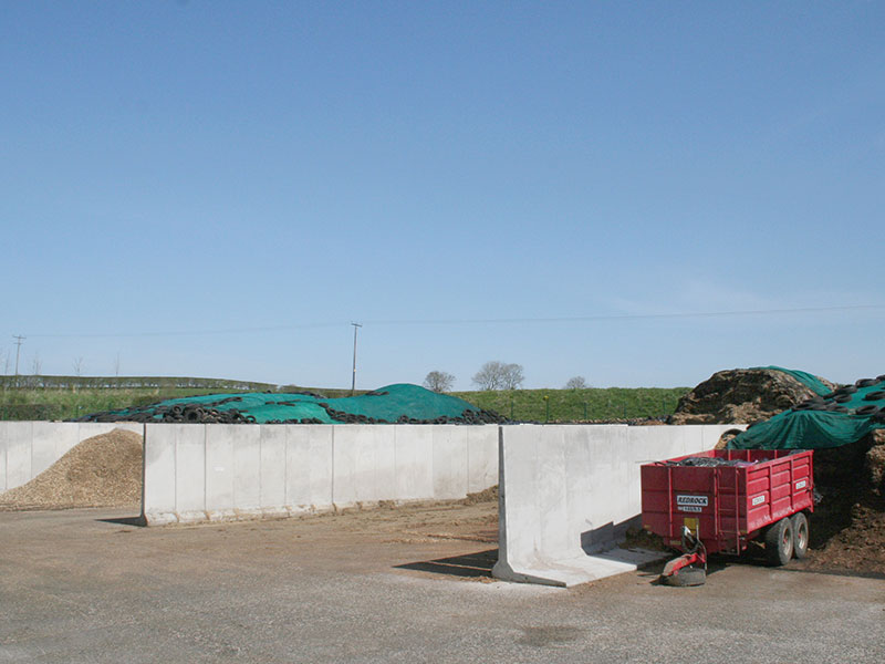 2.4m (8') high Free Standing Retainer or 'L' Walls used to form storage bays for bulk materials to be recycled