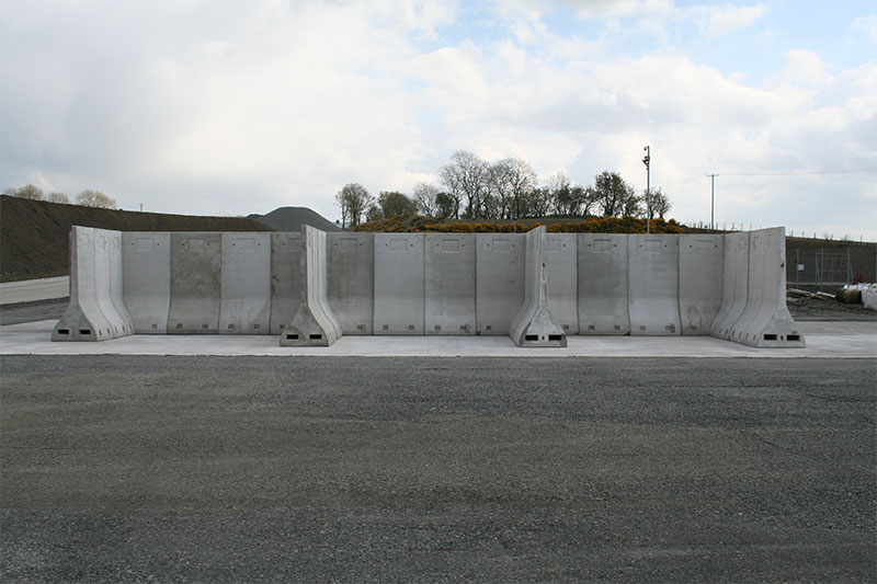 Bays for storage of building materials construcetd using Free Standing Bunker Retainer Walls
