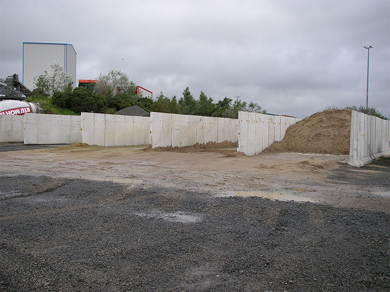 Free Standing Retainer Walls used to form bays for storage and dividing of sand and aggregate